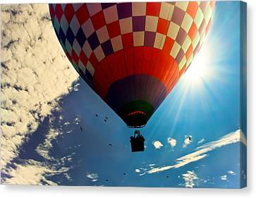 Hot Air Balloon Eclipsing The Sun Canvas Print by Bob Orsillo