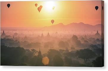 Hot Air Balloon Over Plain And Pagoda Of Bagan In Misty Morning Canvas Print by Anek Suwannaphoom