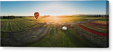 Canvas Print featuring the photograph Hot Air Balloon Taking Off At Sunrise by William Lee