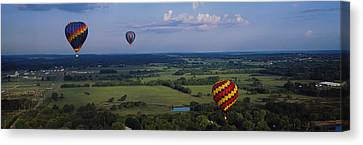 Hot Air Balloons Floating In The Sky Canvas Print by Panoramic Images