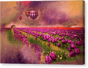 Hot Air Balloons Over Tulip Fields Canvas Print by Jeff Burgess