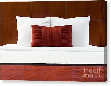 Hotel Room Bed And Pillows Canvas Print by Paul Velgos