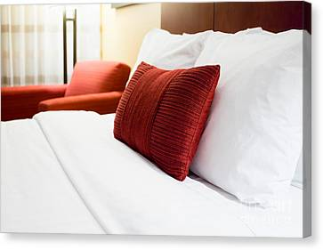 Hotel Room Bed Pillows Canvas Print by Paul Velgos