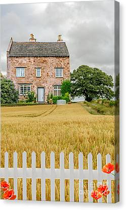 House In Wheat Field Canvas Print