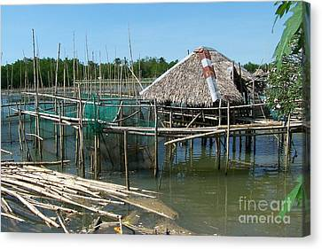 House On Stilts Canvas Print by Dindin Coscolluela