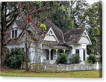 House With A Picket Fence Canvas Print by Lynn Jordan