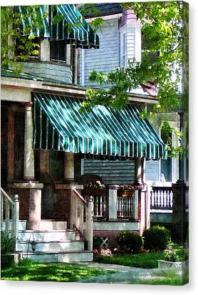 House With Green Striped Awnings Canvas Print by Susan Savad
