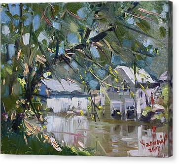 Houses Along The Canal Canvas Print by Ylli Haruni