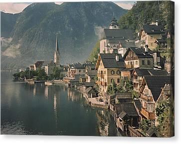 Houses Line The Lake Of Hallstatt Canvas Print by W. Robert Moore