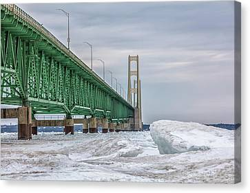 Canvas Print featuring the photograph Ice And Mackinac Bridge  by John McGraw