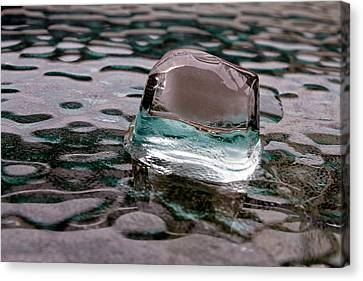 Canvas Print featuring the photograph Ice Cube On Glass V1 by Rico Besserdich