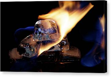 Canvas Print featuring the photograph Ice Cubes Under Fire by Rico Besserdich