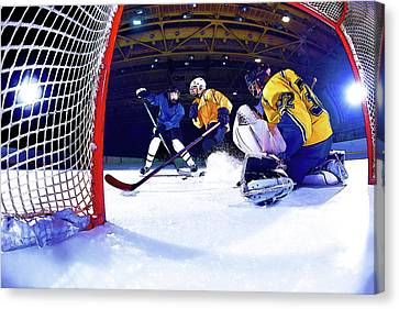 Ice Hockey Battle Through The Cage Canvas Print