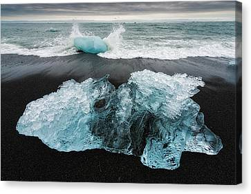 Canvas Print featuring the photograph Iceberg And Black Beach In Iceland by Matthias Hauser