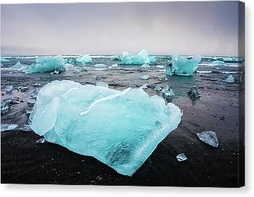 Canvas Print featuring the photograph Iceberg Pieces In Iceland Jokulsarlon by Matthias Hauser