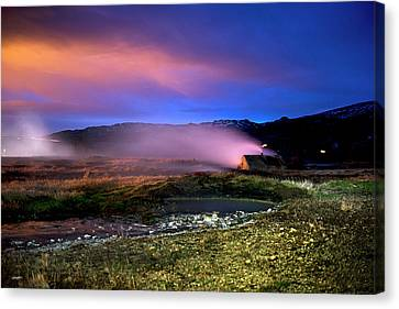 Canvas Print featuring the photograph Icelandic Geyser At Night by Dubi Roman