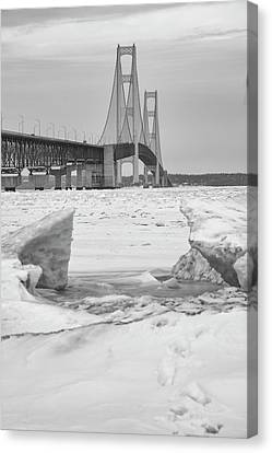 Canvas Print featuring the photograph Icy Black And White Mackinac Bridge  by John McGraw