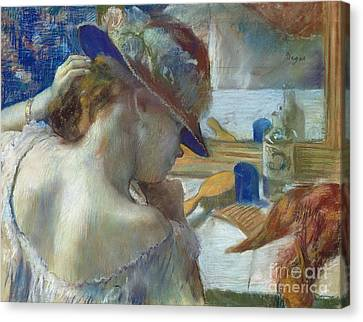 In Front Of The Mirror Canvas Print by Edgar Degas