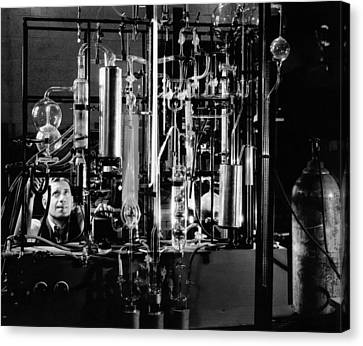 Industrial Chemist Among Glass Tubes Canvas Print by Everett
