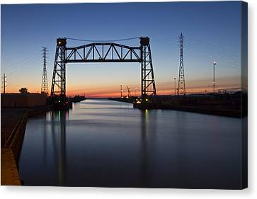 Industrial River Scene At Dawn Canvas Print by Sven Brogren