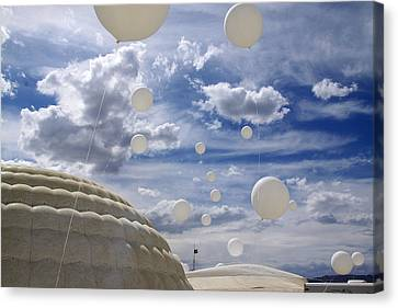 Inflatable World Canvas Print by Menelaos Prokos