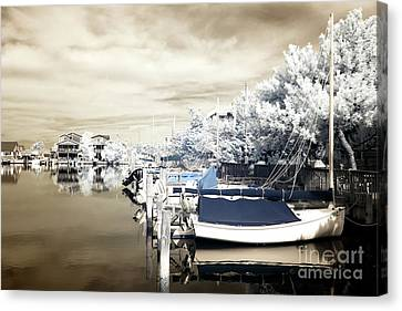 Infrared Boats At Lbi Blue Canvas Print by John Rizzuto