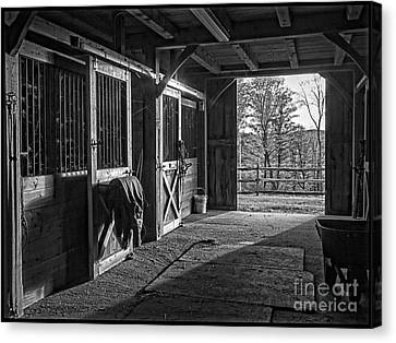Canvas Print featuring the photograph Inside The Horse Barn Black And White by Edward Fielding