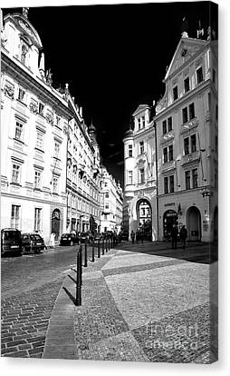 Into Prague Old Town Square Canvas Print by John Rizzuto