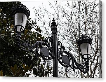 Intricate Ironwork Streetlights On An Interesting Green And Gray Background Canvas Print by Georgia Mizuleva