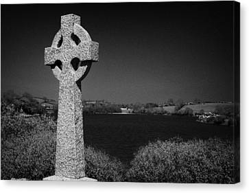Irish Celtic Cross Overlooking Lake Canvas Print by Joe Fox