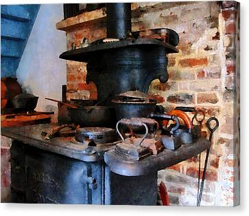 Irons Heating On Stove Canvas Print by Susan Savad