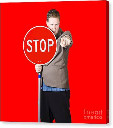 Isolated Man Holding Red Traffic Stop Sign Canvas Print