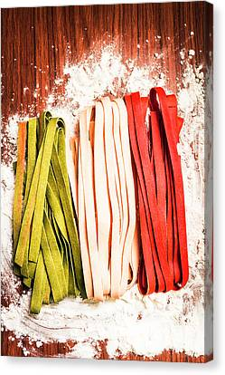 Italian Pasta In National Flag On Flour Canvas Print by Jorgo Photography - Wall Art Gallery