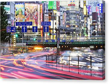 Japanese Downtown Traffic At Dusk Canvas Print by Jeremy Woodhouse