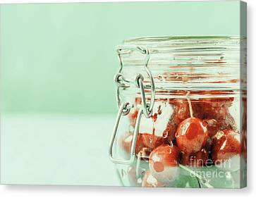 Jar Of Red Fresh Cherries On Turquoise Background Canvas Print by Radu Bercan