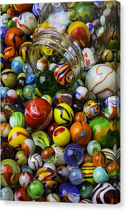 Jar Pouring Out Glass Marbles Canvas Print