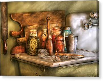 Jars - The Process Of Canning Canvas Print by Mike Savad