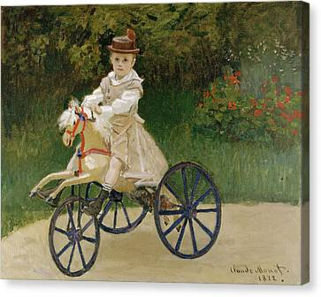 Jean Monet On His Hobby Horse           Canvas Print by Claude Monet