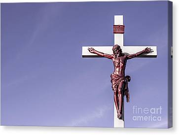 Canvas Print featuring the photograph Jesus Crucifix Against The Sky by Gary Whitton