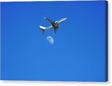 Jet Plane Flying Over The Moon Canvas Print