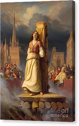 Joan Of Arc's Death At The Stake Canvas Print by Hermann Anton Stilke