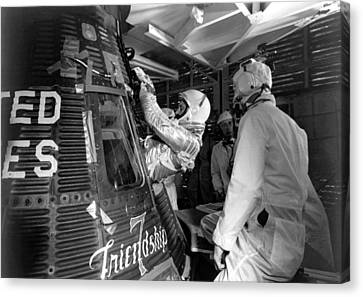John Glenn Entering Friendship 7 Spacecraft Canvas Print by War Is Hell Store