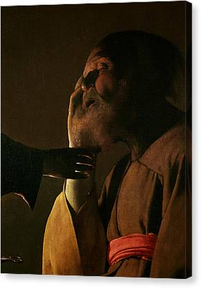 Joseph And The Angel Canvas Print by Georges de la Tour