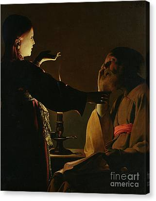 Jospeh And The Angel Canvas Print by Georges de la Tour