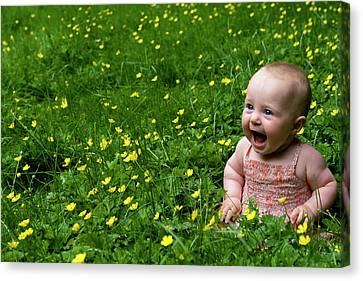 Joyful Baby In Flowers Canvas Print
