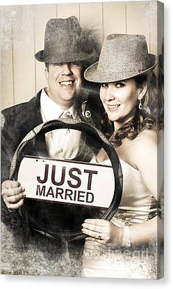 Just Married Bride And Groom Driving To Honeymoon Canvas Print