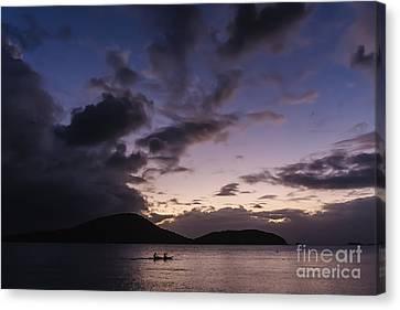 Kayak At Sunset Canvas Print by Ernesto Ruiz