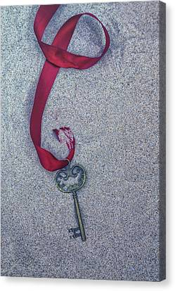 Key Buried In The Sand Canvas Print