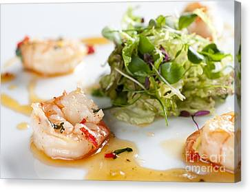 King Prawns Ginger Chilli And Coriander Starter Presented On A White Background Canvas Print by Andy Smy