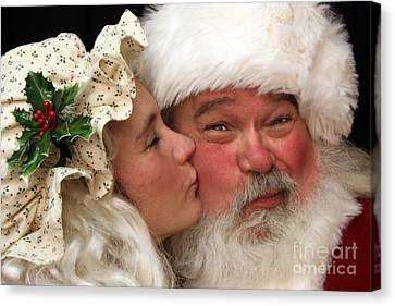 Kissing Santa Claus Canvas Print by Joanne Coyle